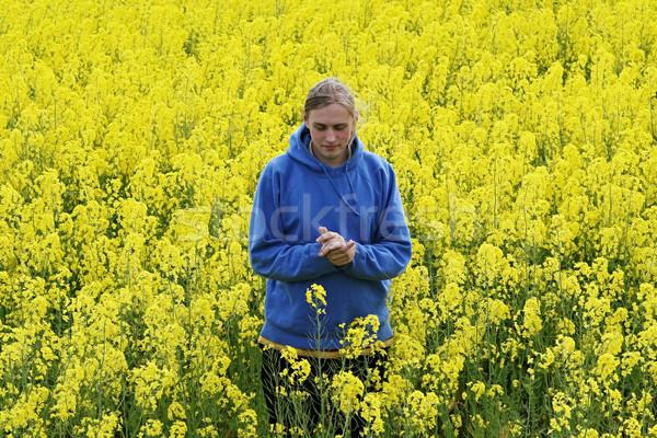 男 花 草原 幸せ 若い男 黄色の花 ストックフォト © fotorobs