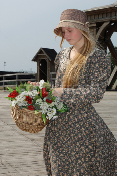 Girl with basket of flowers Stock photo © fotorobs
