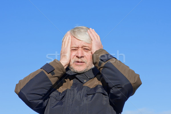 Portrait of middle-aged man on blue sky of the background. Stock photo © fotorobs