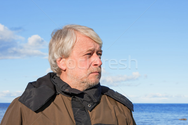 Portrait of middle-aged man at the sea. Stock photo © fotorobs