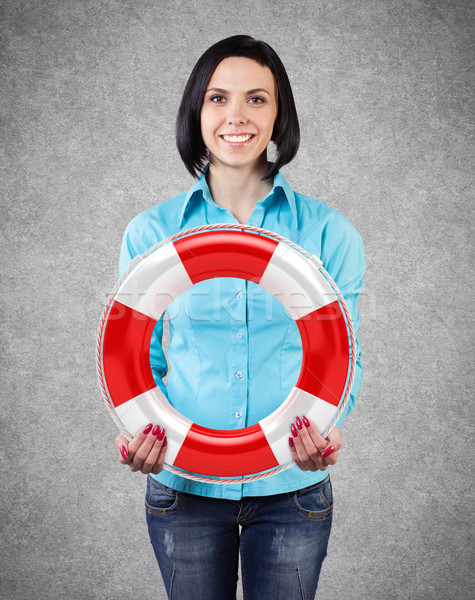 Girl with a lifebuoy Stock photo © FotoVika