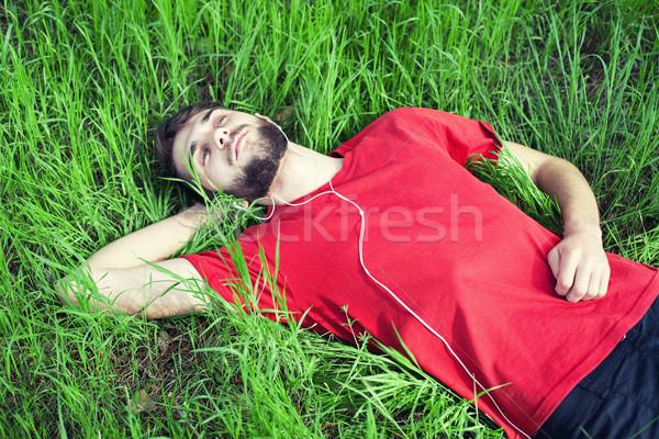 Jongen gras groen gras muziek zomer ontspannen Stockfoto © FotoVika