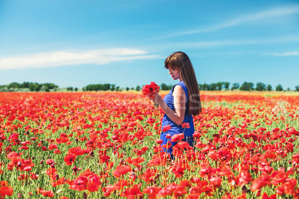 Menina beautiful girl vermelho campo flor Foto stock © FotoVika