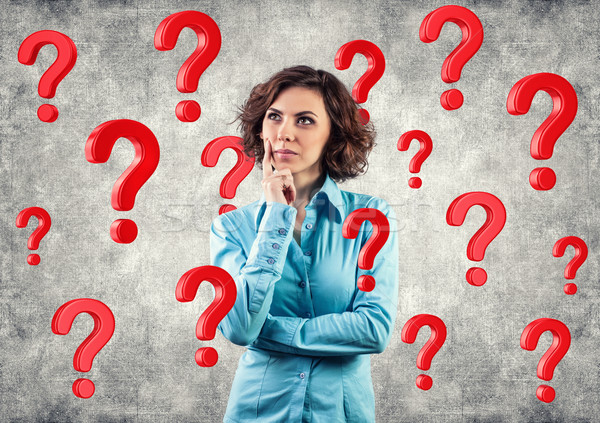 Stock photo: Girl among questions