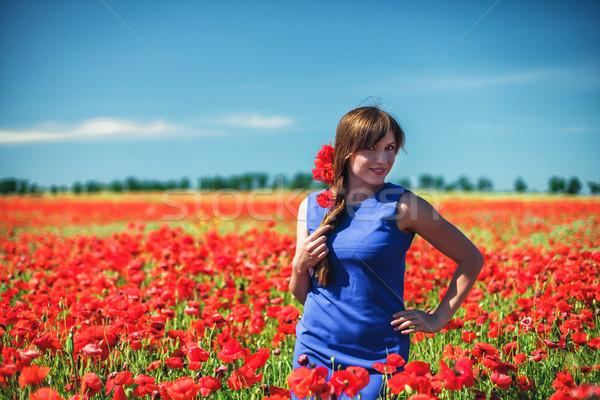 девушки красивая девушка красный области цветок Сток-фото © FotoVika