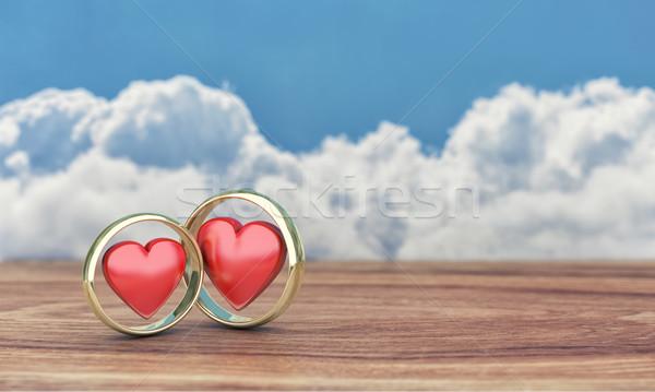 Zwei Gold Ringe Illustration Holztisch Liebe Stock foto © FotoVika