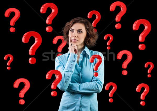Girl among questions Stock photo © FotoVika