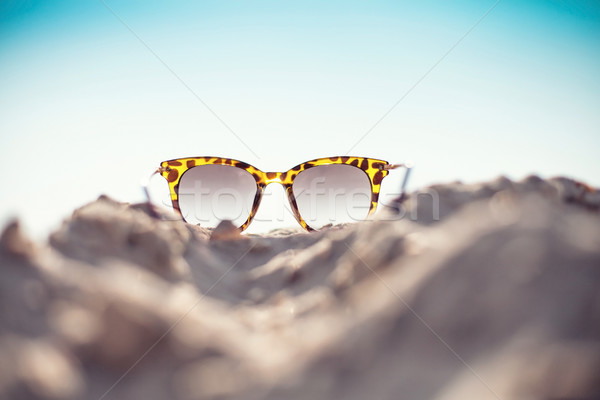 Glasses on a beach Stock photo © FotoVika