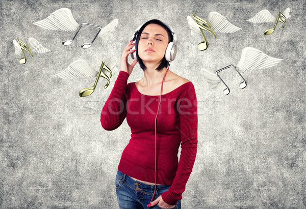 Girl with earphones Stock photo © FotoVika