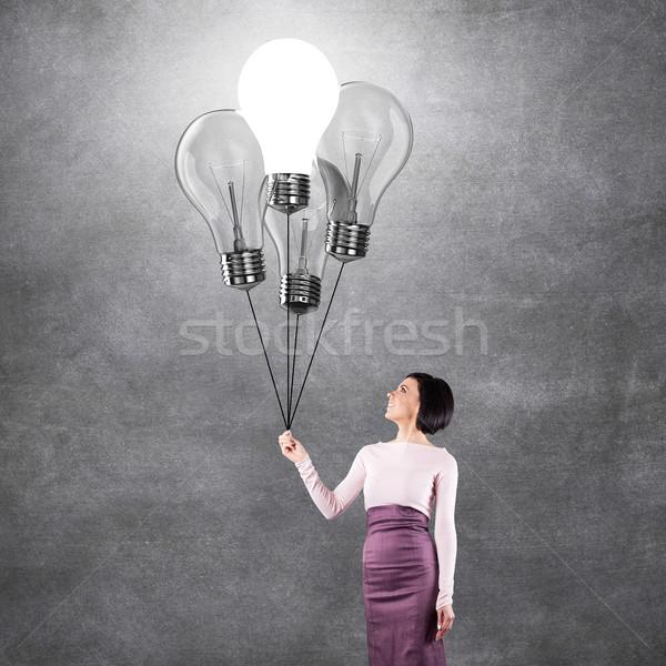 Girl with lightbulbs Stock photo © FotoVika