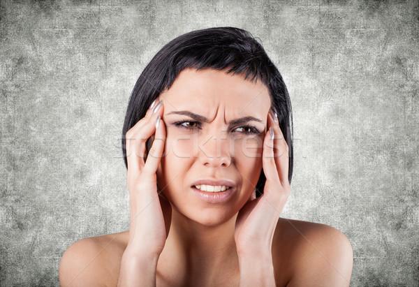 Nina doloroso cabeza gris mujer mano Foto stock © FotoVika