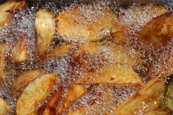 Potato Wedges Frying Stock photo © fouroaks