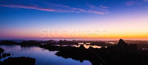 Puesta de sol rocas costa hermosa Sudáfrica nubes Foto stock © fouroaks
