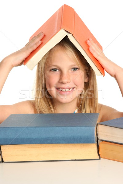 Cute Young School Girl Reading Books Stock photo © fouroaks