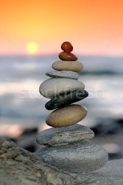 日没 石 バランスのとれた 石 海 ストックフォト © fouroaks