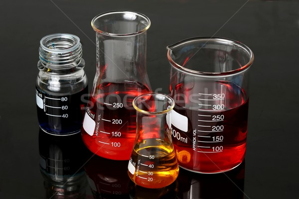 Laboratorio cristalería rojo azul amarillo soluciones Foto stock © fouroaks