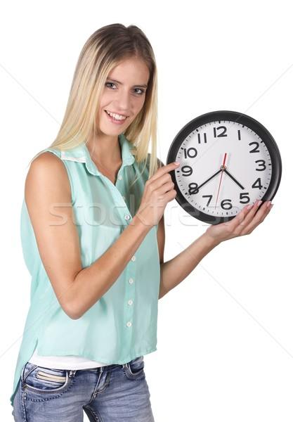 Pretty Lady Pointing to Clock Stock photo © fouroaks