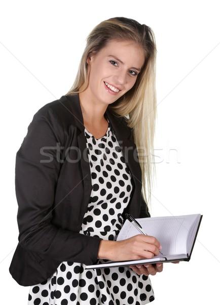 Glimlachende vrouw schrijven dagboek glimlachend kantoormedewerker manager Stockfoto © fouroaks