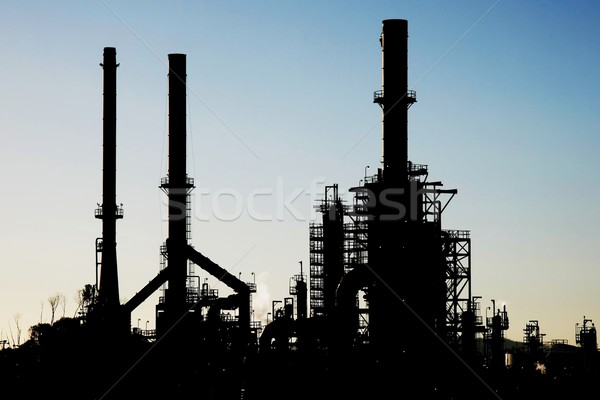Silhouette of an oil refinery with chimneys Stock photo © fouroaks