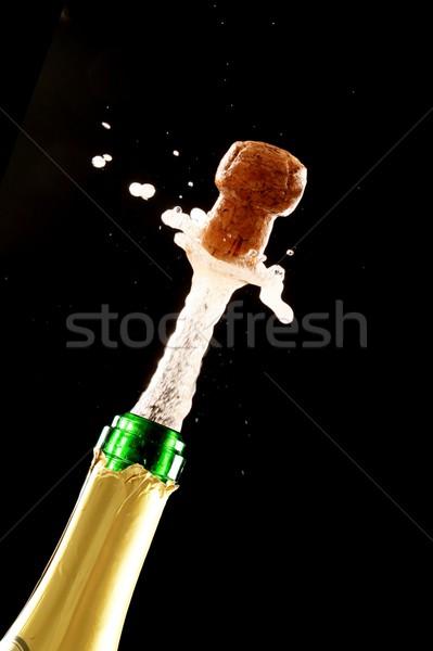 Cortiça tiroteio fora champanhe garrafa verde Foto stock © fouroaks
