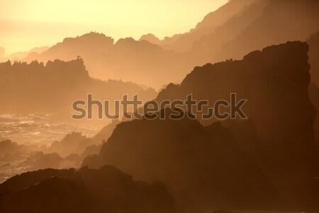 日没 岩 海 シルエット ストックフォト © fouroaks