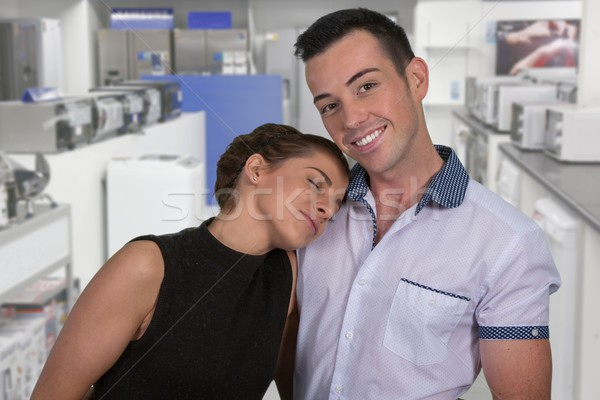 Stock photo: Happy Couple in Appliance Store