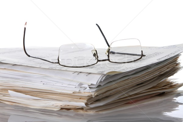 Stock photo: Reading Glasses and Work Papers