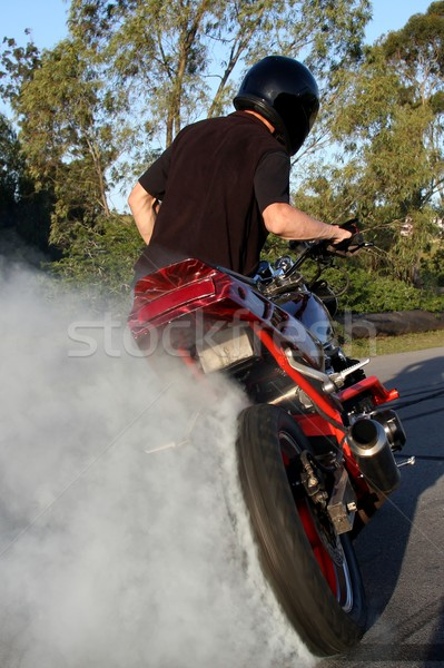 Motorbike Rider Doing Stunt Stock photo © fouroaks