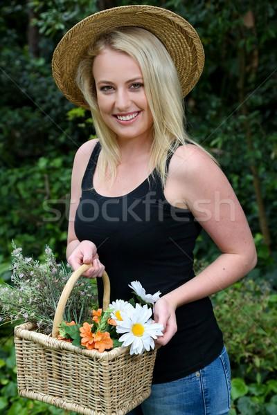 Pretty Gardening Woman with Flowers Stock photo © fouroaks