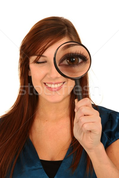 Pretty Woman and Magnifying Glass Stock photo © fouroaks