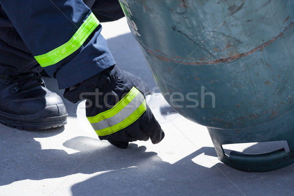 fire trainer, pouring liquid LPG gas into bottle by upside down  Stock photo © FrameAngel