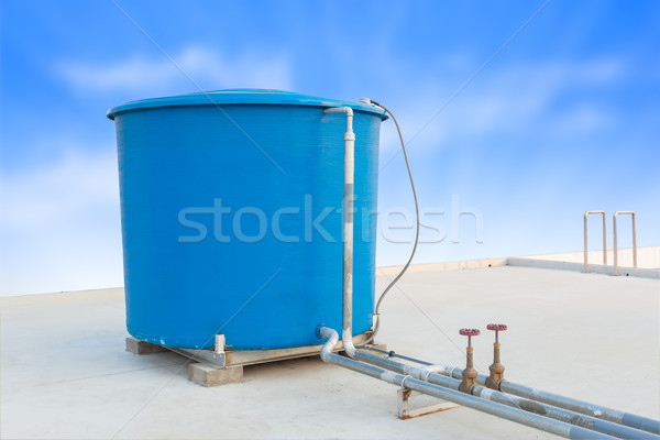 Blue water tank of industrial building on roof top and blue clou Stock photo © FrameAngel