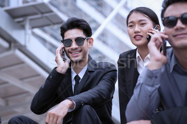 ビジネスマン 女性 幸せ 座って 携帯電話 ストックフォト © FrameAngel