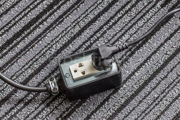 Electrical socket with power plug cable on carpet floor for safe Stock photo © FrameAngel