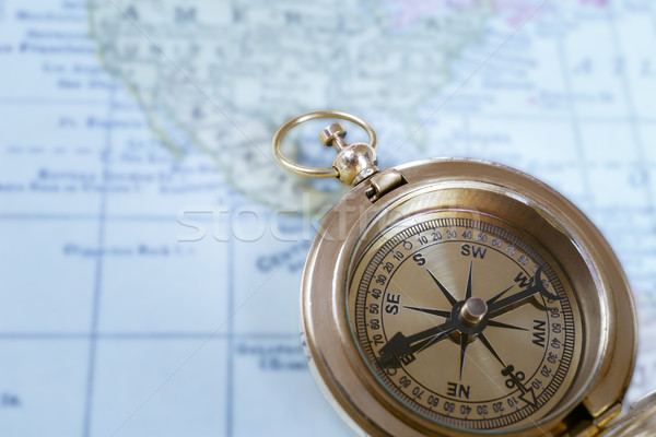 Compass on map background, use for travel concept Stock photo © FrameAngel