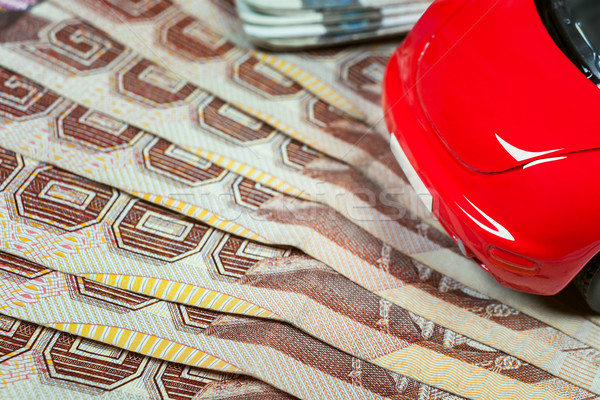 Thai baht banknotes and car mockup closeup on table background Stock photo © FrameAngel