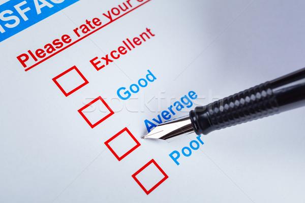 Satisfacción del cliente estudio caja pluma senalando promedio Foto stock © FrameAngel