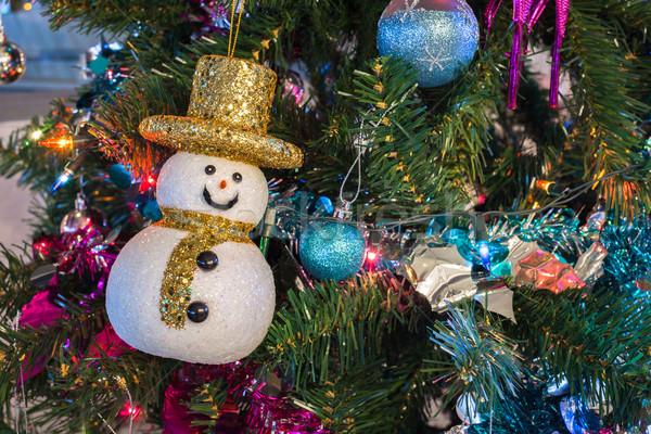 Boneco de neve natal árvore de natal casa luzes Foto stock © FrameAngel