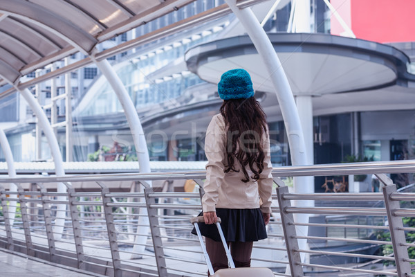 Asian Travel woman wearing sweater coat, blue yarn hat with lugg Stock photo © FrameAngel