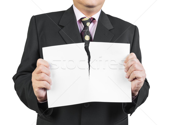 Businessman tearing sheet white paper on white background Stock photo © FrameAngel