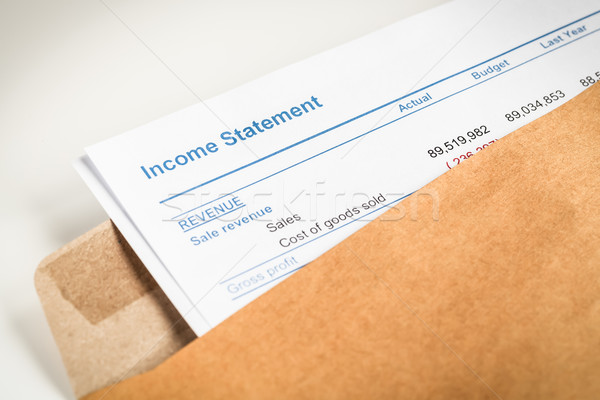 Income statement letter in brown envelope opening, business conc Stock photo © FrameAngel