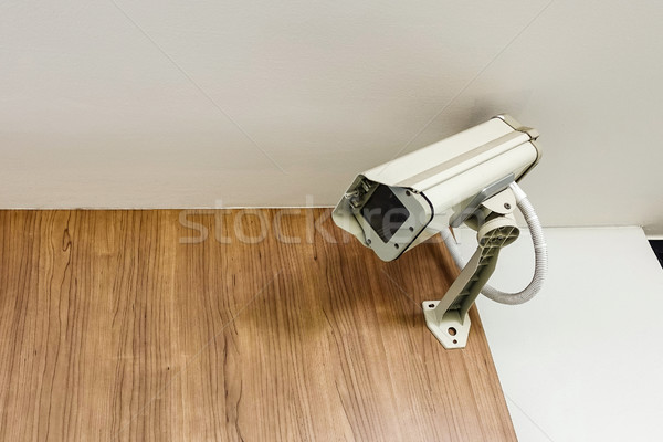 cctv camera security on wall background for safety concept Stock photo © FrameAngel
