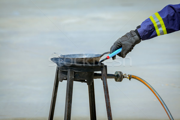 fire trainer hand,how to ignite or light gas at stove for confla Stock photo © FrameAngel