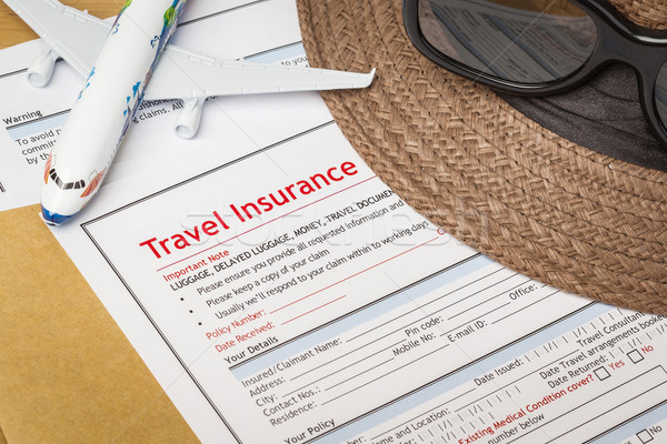 Travel Insurance Claim application form and hat with eyeglass on Stock photo © FrameAngel