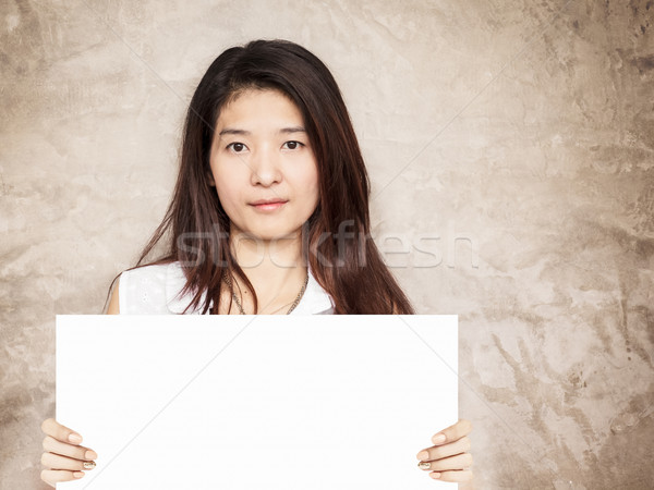 young asian woman holding blank sign Stock photo © FrameAngel
