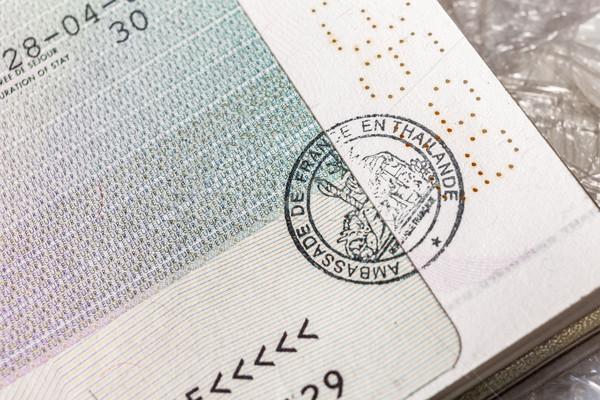 Passport stamp visa for travel concept background, Paris France Stock photo © FrameAngel