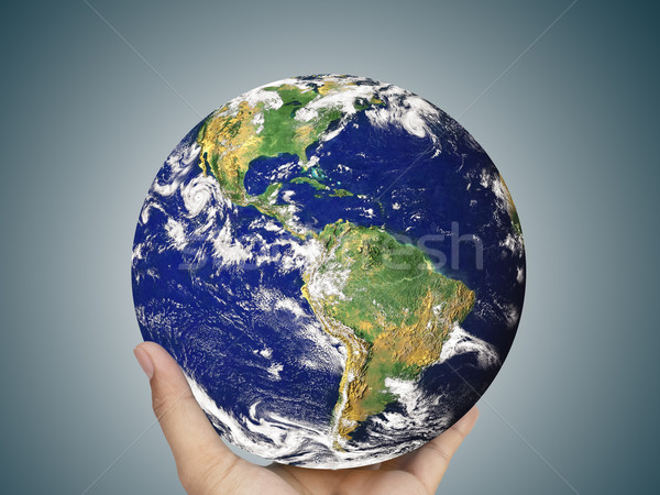 earth globe in hand, 'Elements of this image furnished by NASA' Stock photo © FrameAngel