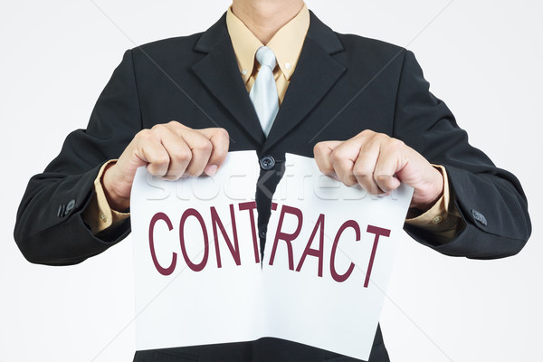 Businessman tearing sheet paper, contract management concept Stock photo © FrameAngel
