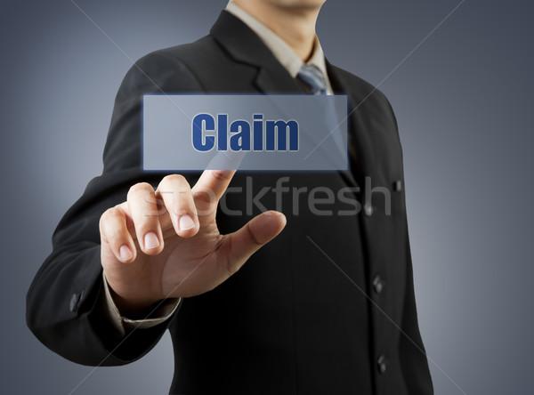businessman hand pushing Claim button Stock photo © FrameAngel