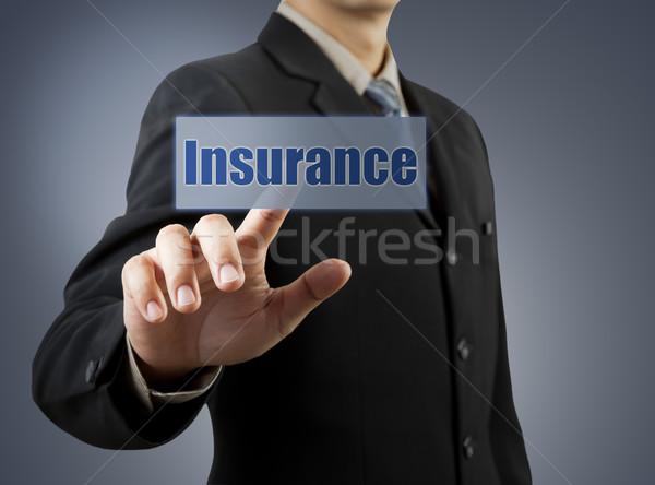 businessman hand pushing insurance button Stock photo © FrameAngel